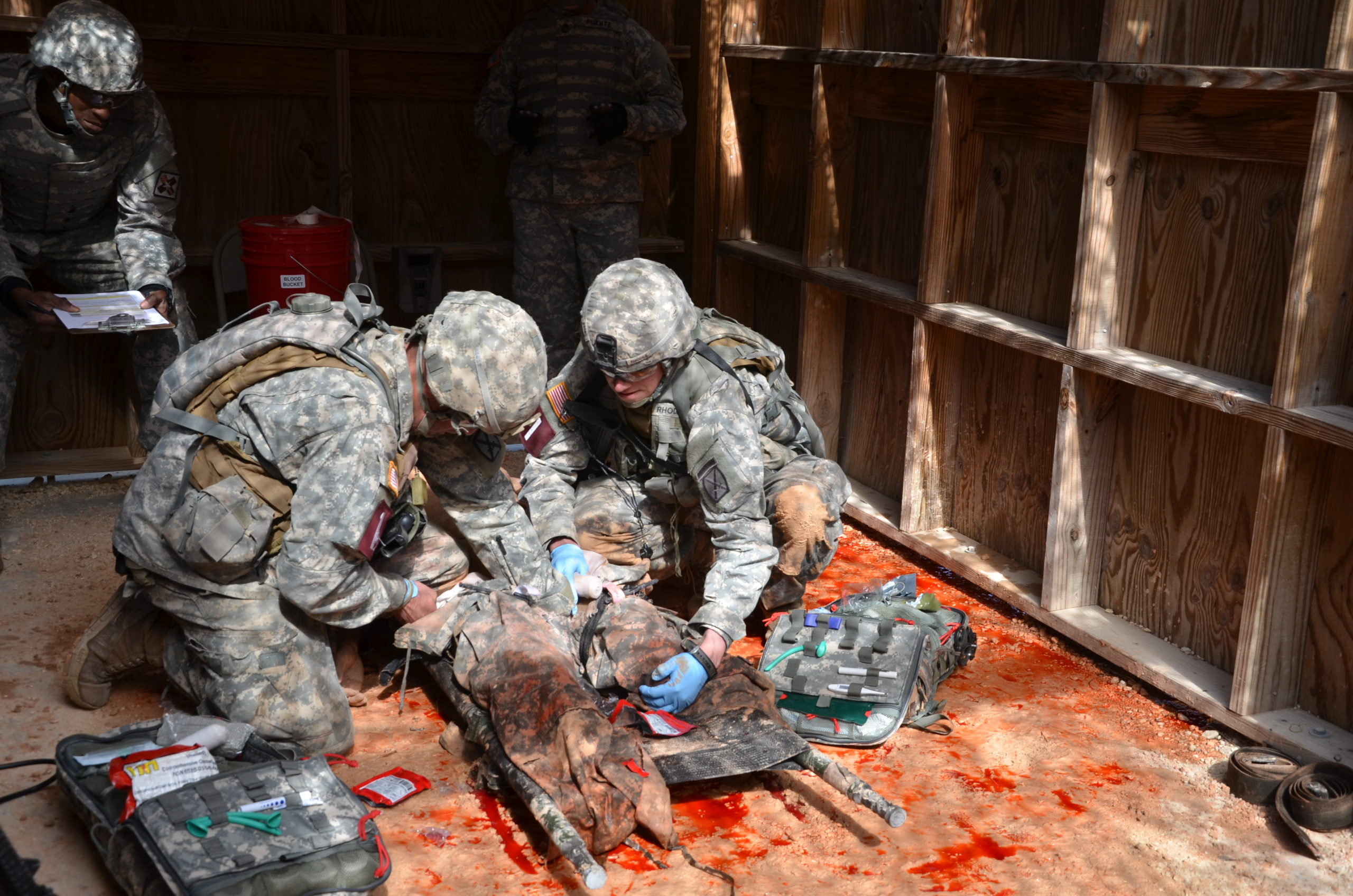Sgt. Ryan Savoy and Spc. Caleb Rhodes, representing the 10th Mountain Division, Fort Drum, N.Y., perform combat casualty care during the Command Sgt. Maj. Jack L. Clark Jr. U.S. Army Best Medic Competition Oct. 26 to 28 at Joint Base San Antonio-Camp Bullis. (Photo Credit: Lori Newman, JBSAFort Sam Houston Public Affairs)
